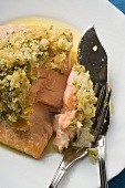 Salmon fillet with gratin topping, fish cutlery