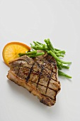 Grilled T-bone steak with French beans