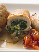 Veal rolls with spinach stuffing and tomatoes