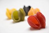 Coloured lumaconi (pasta shells)