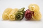 Coloured riccioli in a row