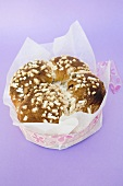 Yeast cake with sugar, gift-wrapped for Easter
