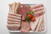 Cold cuts platter with cherry tomatoes & parsley (overhead)