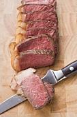 Beef steak with fatty edge, sliced