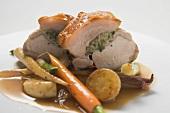 Roast pork with crackling, herb stuffing & vegetables