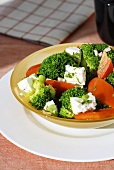 Broccoli salad with peppers and sheep's cheese