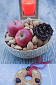 Christmas decoration with apples, nuts, candle & gingerbread