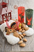 Christmas decoration with apples, almonds, lantern, mittens