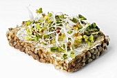 Radish sprouts on buttered whole-grain bread