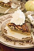 Piece of pecan pie with cream for Thanksgiving
