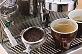 Two cups of espresso on espresso machine