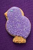 Easter biscuit (purple chick) on purple linen
