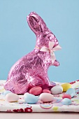 Easter Bunny and sugar eggs on coloured cloth