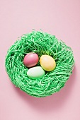 Three sugar eggs in Easter nest