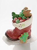 Christmas biscuits and sweets in chocolate boot