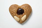 Gingerbread heart with almonds