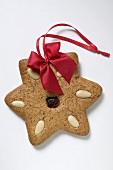 Gingerbread star with almonds and red bow
