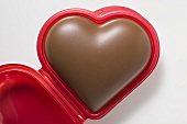 Chocolate heart in red plastic box