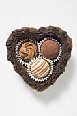 Three chocolates in a chocolate heart