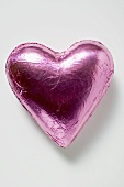 Chocolate heart in pink foil