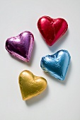 Four chocolate hearts in coloured foil