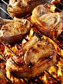 Pork chops on barbecue rack