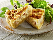 Two pieces of quiche Lorraine with salad leaves