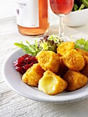 Breaded cheese cubes with cranberry jam