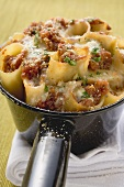 Baked cannelloni with mince filling and cheese topping
