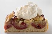 Piece of plum cake with cream