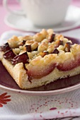 Piece of plum cake in front of coffee cup