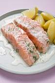 Salmon fillets with dill sauce and boiled potatoes
