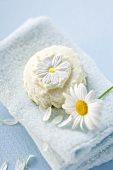 Marguerite soap and marguerite on towel