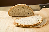 Wholemeal bread with rolled oats, partly sliced