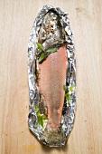 Salmon trout in aluminium foil