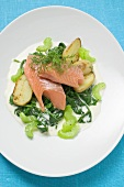 Salmon trout fillet with spinach, celery and potatoes