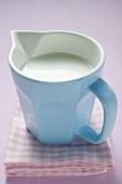 Milk in small jug on tea towel