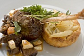 Braised goose leg with pear and onion tart