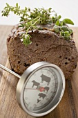 Roast beef with herbs, meat thermometer