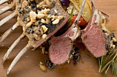 Rack of lamb with pesto and pine nut crust, vegetables