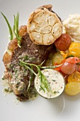 Beef steak with garlic, cherry tomatoes and mustard butter