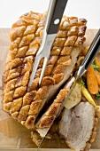 Roast belly pork with crackling and vegetables