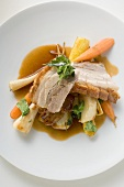 Roast belly pork with crackling and root vegetables