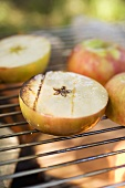 Grilled apples on barbecue grill rack