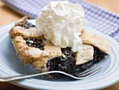 Piece of blueberry pie with cream