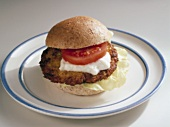 Fish burger with tomato and sour cream