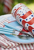 Paper cups and forks on a plate for the 4th of July (USA)