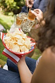 Young people with crisps & iced tea on the 4th of July (USA)