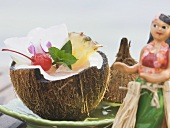 Coconut drink with pineapple, cocktail cherry and orchid