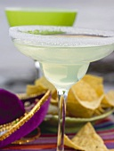 Margarita in glass with salted rim, tortilla chips (Mexico)